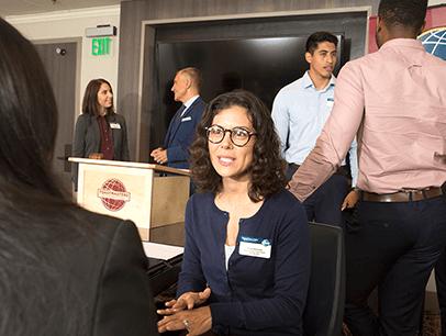 Woman speaking to someone at meeting