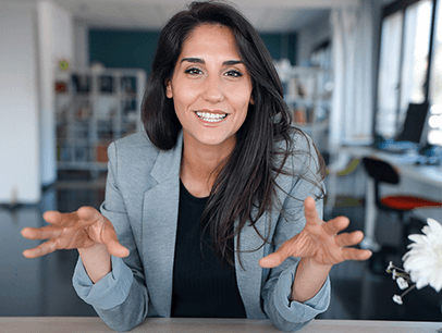 Woman speaking to camera using hand gestures