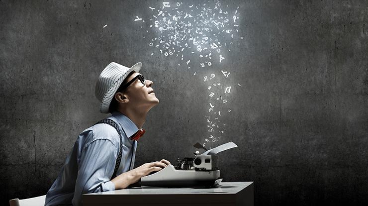 Man working on typewriter