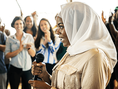 Woman wearing hijab holding microphone