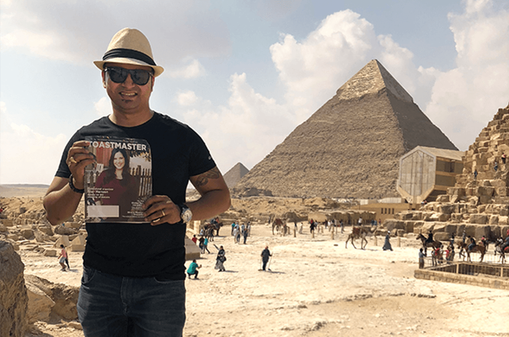 Christopher Keith Almeida, DTM, of Doha, Qatar, stands near the Great Pyramid of Giza, also known as the Pyramid of Khufu, in Cairo, Egypt, prior to the pandemic.
