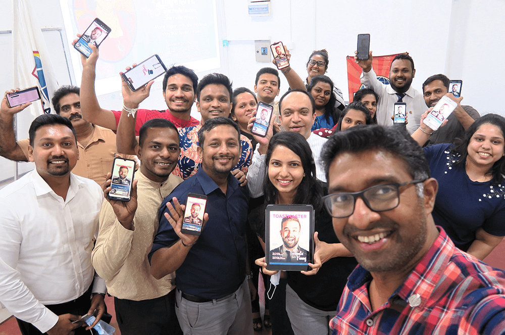 Sri Lanka Institute of Marketing Toastmasters Club members in Colombo, Sri Lanka, pose with the digital edition of the Toastmaster at their club meeting.