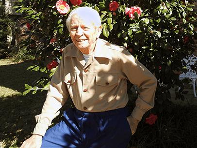 Man wearing tan shirt and smiling