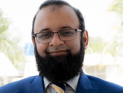 Man wearing glasses with beard