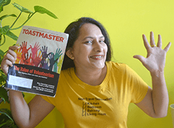 Sushma Harish of Doha, Qatar, keeps her spirits and positivity high while reading her Toastmaster in quarantine.