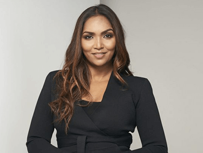 Woman posing in black suit