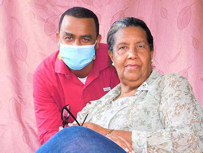 Man wearing mask posing next to woman
