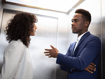 Man and woman speaking in elevator