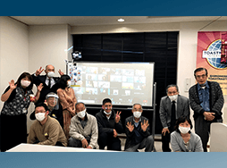 Group of people in masks posing