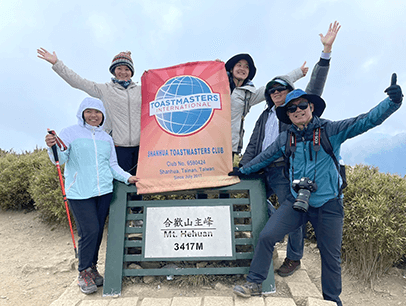 Shanhua Toastmasters members of Tainan, Taiwan, show their club support as they climb Mt. Hehuan, also called Joy Mountain, in the Taroko National Park.