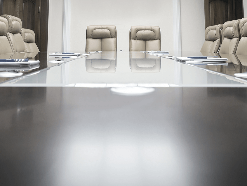 Empty chairs in board room