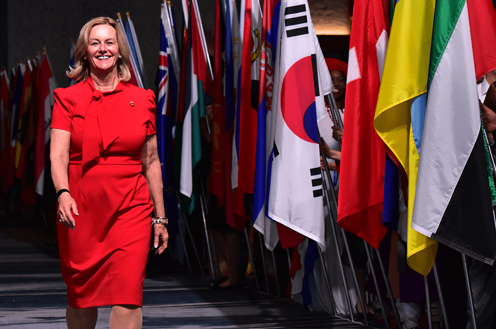 Page proudly walks past the display of flags at the 2018 International Convention in Chicago, Illinois.
