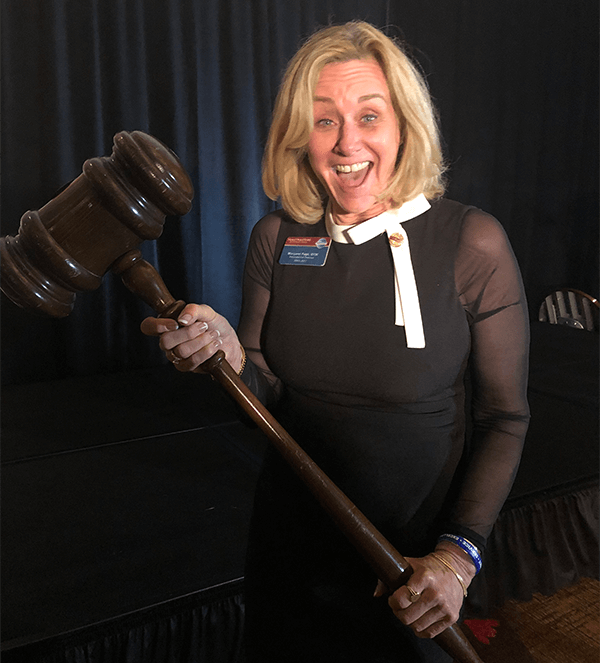 Page borrows a giant gavel from District 39 while campaigning for Second Vice President in 2018.