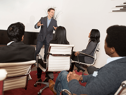 Man speaking to group of people