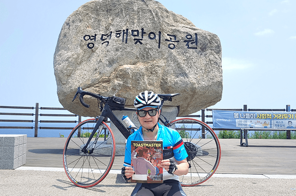 Sean Jung, DTM, of Seoul, South Korea, completes a 76-kilometer (47.2-mile) bicycle ride at Sunrise Park in Yeongdeok, South Korea.