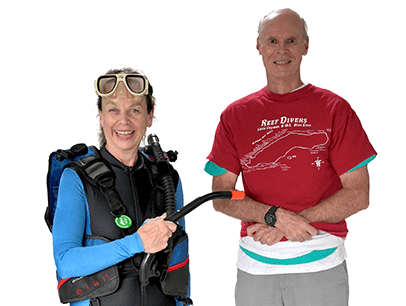 Woman in scuba gear next to man in red shirt