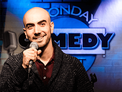 Man holding microphone on comedy stage