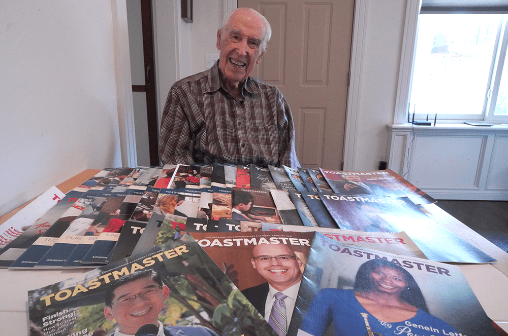 Oren Lee Peters of Edmond, Oklahoma, shows off his collection of Toastmaster magazines.
