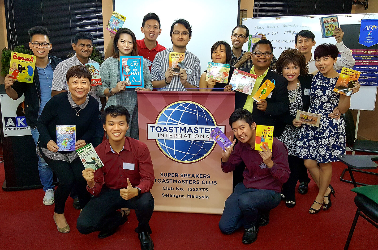 Thirty two guests and members of the Manama Toastmasters club in Manama, Bahrain, show off the prizes they won at during the club's bowling tournament.