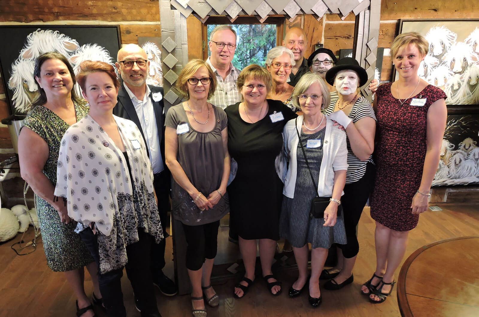 Members of Toastmasters des Laurentides club in Quebec, Canada, host an open house in the Art Gallery Béliveau for their 15th anniversary.