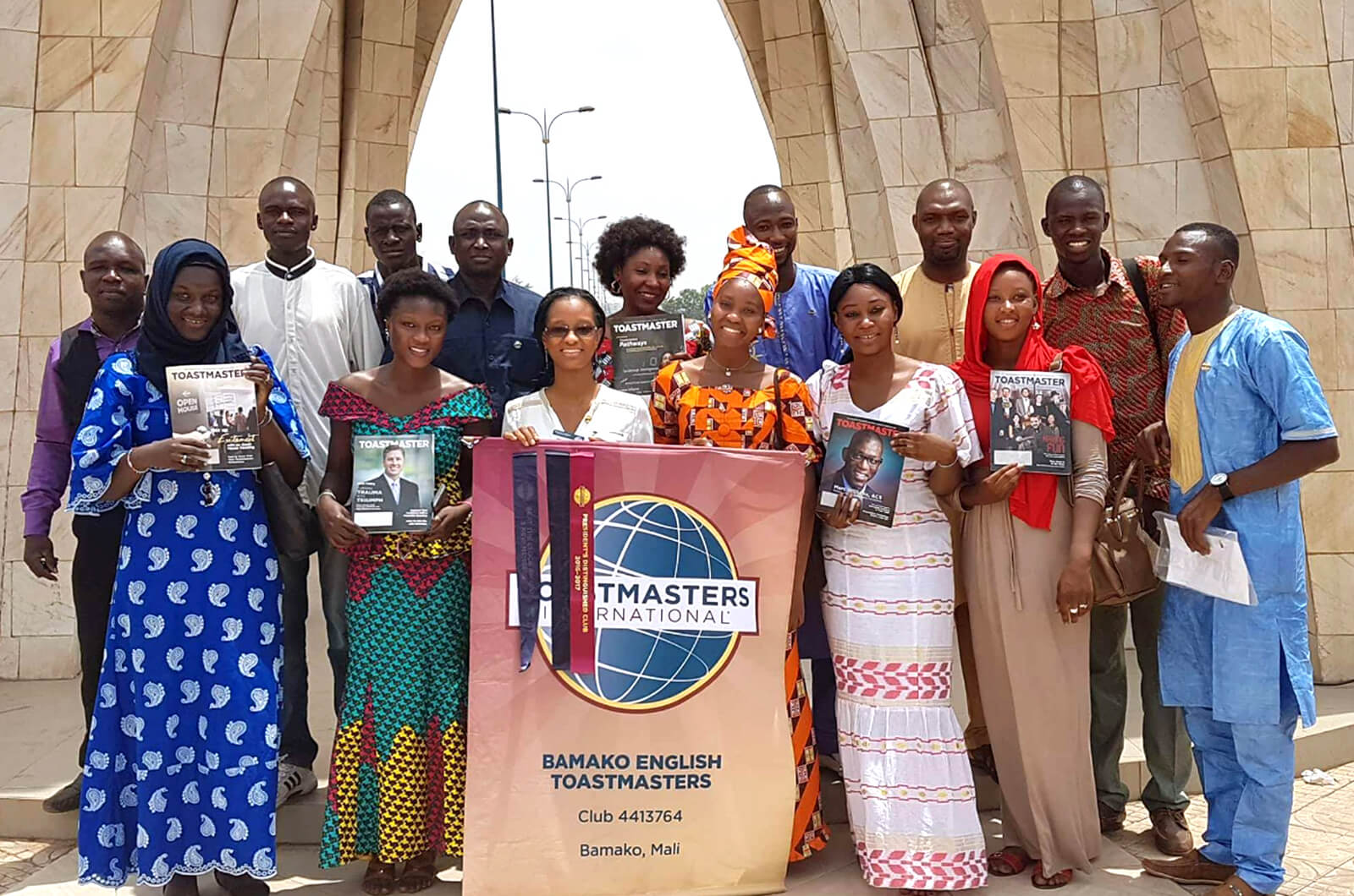 Bamako English Toastmasters club members gather under the Place de l'indépendance monument in Bamako, Mali.